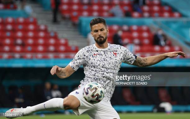 France's forward Olivier Giroud kicks the ball during warm up before the start of the UEFA EURO 2020 Group F football match between Portugal and...