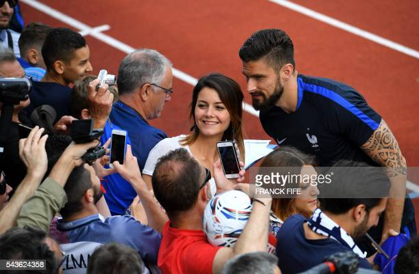 France's forward Olivier Giroud poses for pictures before a training session in Clairefontaine-en-Yvelines, southwest of Paris, on June 29 during the...