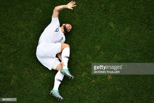 TOPSHOT France's forward Olivier Giroud reacts after a challenge during the Russia 2018 World Cup quarterfinal football match between Uruguay and...