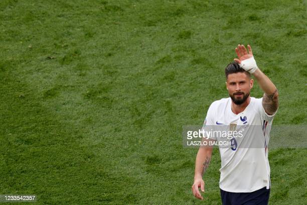 France's forward Olivier Giroud reacts after the UEFA EURO 2020 Group F football match between Hungary and France at Puskas Arena in Budapest on June...