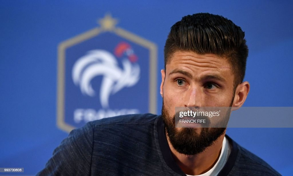 France's forward Olivier Giroud reacts as he arrives for a press conference at the press centre in Istra, west of Moscow on July 8, 2018, during the Russia 2018 World Cup football tournament.
