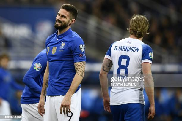 France's forward Olivier Giroud reacts next to Iceland's midfielder Birkir Bjarnason during the UEFA Euro 2020 Group H qualification football match...