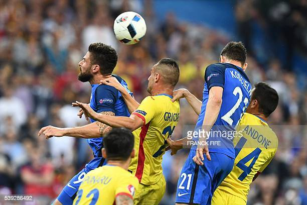 France's forward Olivier Giroud Romania's defender Dragos Grigore France's defender Laurent Koscielny and Romania's forward Florin Andone vie for the...