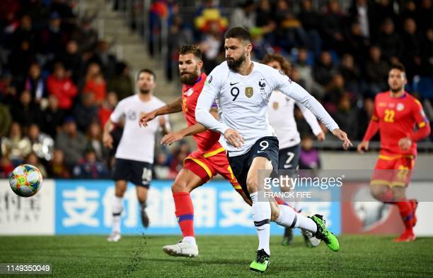 France's forward Olivier Giroud runs with the ball during the UEFA Euro 2020 qualification football match between Andorra and France at the National...