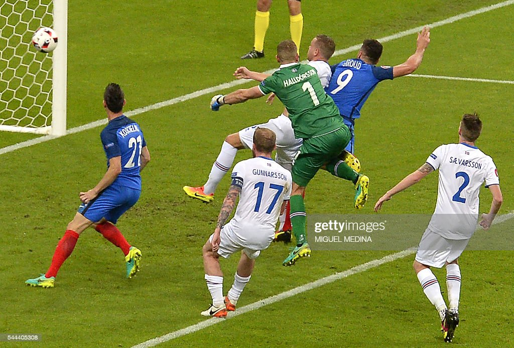 France's forward Olivier Giroud (2R) scores his team's fifth goal during the Euro 2016 quarter-final football match between France and Iceland at the Stade de France in Saint-Denis, near Paris, on July 3, 2016. MEDINA