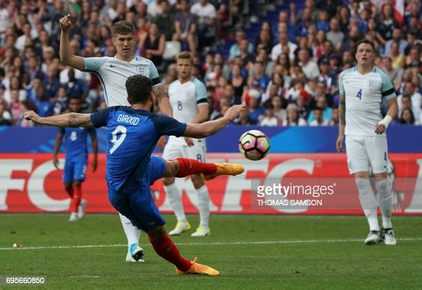 France's forward Olivier Giroud shoots towards goal during the international friendly football match between France and England at The Stade de...