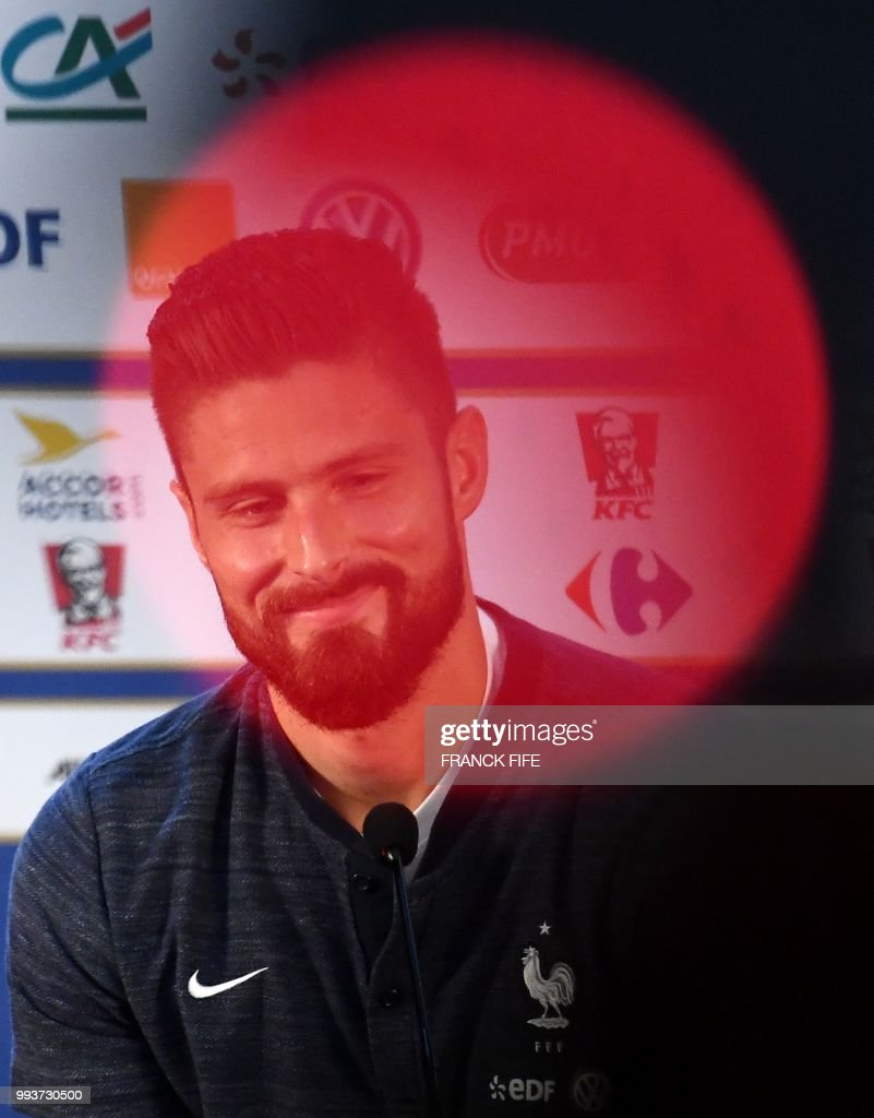 France's forward Olivier Giroud smiles as he gives a press conference at the press centre in Istra, west of Moscow on July 8, 2018, during the Russia 2018 World Cup football tournament.
