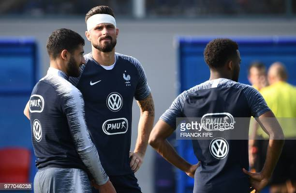 France's forward Olivier Giroud speaks with France's forward Nabil Fekir during the friendly football match against a selection of 19yearold players...