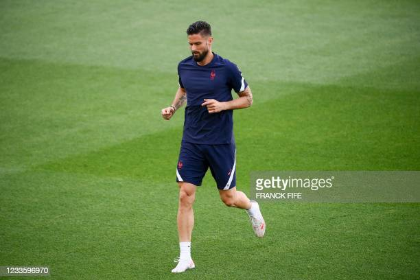 France's forward Olivier Giroud takes part in a MD-1 training session at the Hidegkuti Stadium in Budapest on June 22 on the eve of their UEFA EURO...