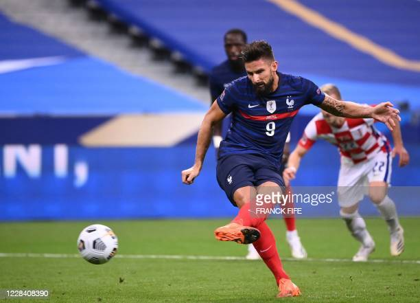 France's forward Olivier Giroud transforms a penalty during the UEFA Nations League Group C football match between France and Croatia on September 8,...