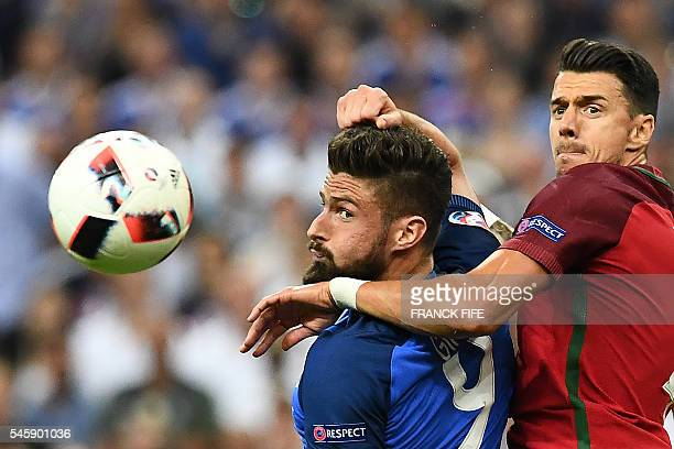 TOPSHOT France's forward Olivier Giroud vies for the ball against Portugal's defender Fonte during the Euro 2016 final football match between France...