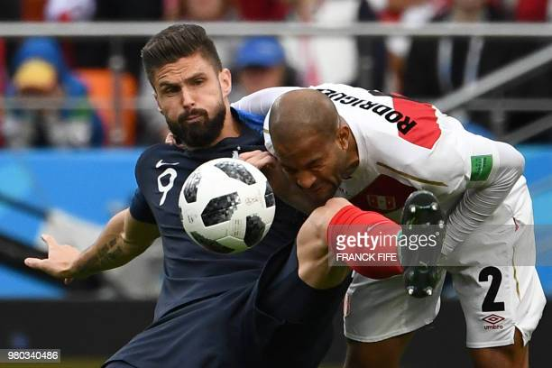 France's forward Olivier Giroud vies for the ball with Peru's defender Alberto Rodriguez during the Russia 2018 World Cup Group C football match...