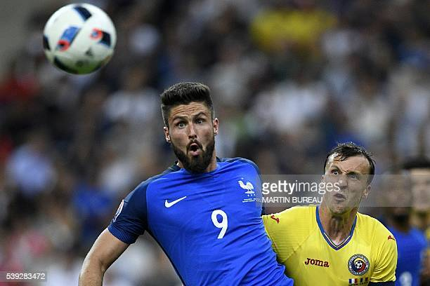 France's forward Olivier Giroud vies for the ball with Romania's defender Vlad Chiriches during the Euro 2016 group A football match between France...