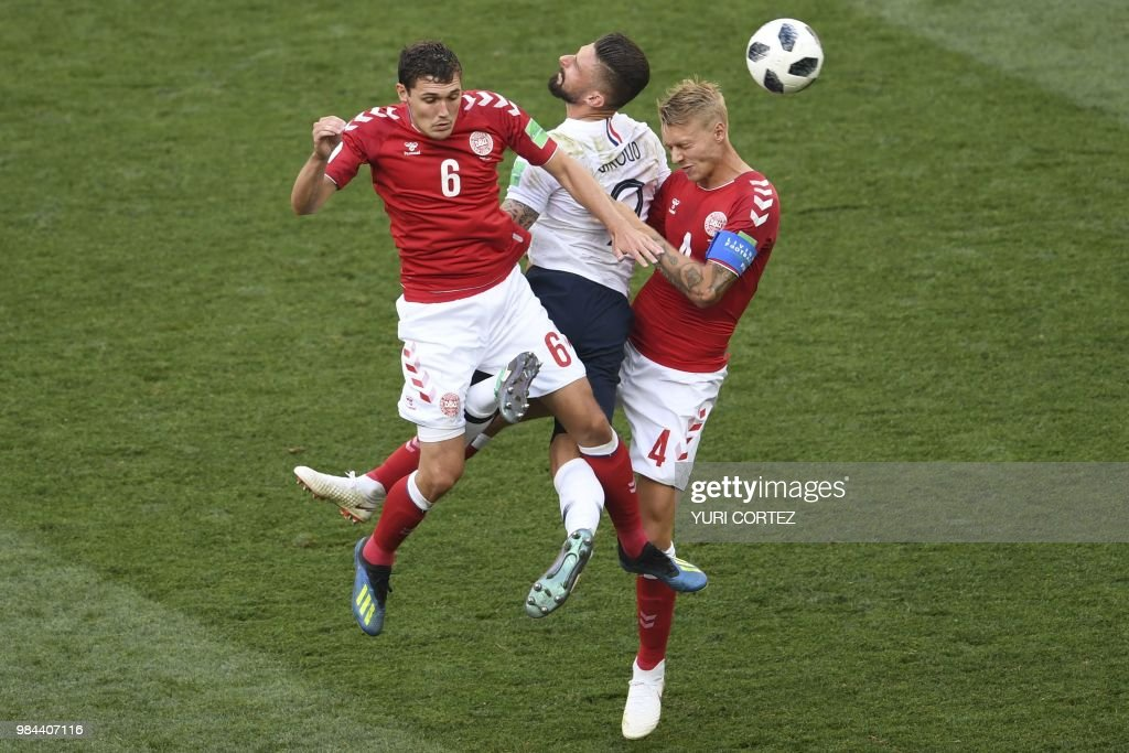 TOPSHOT - France's forward Olivier Giroud (C) vies for the header with Denmark's defender Andreas Christensen (L) and Denmark's defender Simon Kjaer during the Russia 2018 World Cup Group C football match between Denmark and France at the Luzhniki Stadium in Moscow on June 26, 2018. (Photo by YURI CORTEZ / AFP) / RESTRICTED