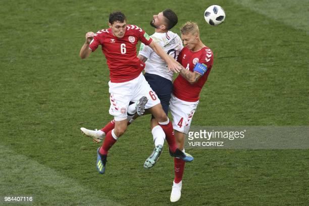TOPSHOT France's forward Olivier Giroud vies for the header with Denmark's defender Andreas Christensen and Denmark's defender Simon Kjaer during the...