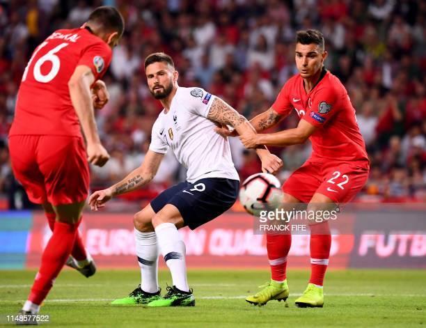 TOPSHOT France's Forward Olivier Giroud vies with Turkey's defender Merih Demiral and Turkey's defender Kaan Ayhan during the Euro 2020 football...