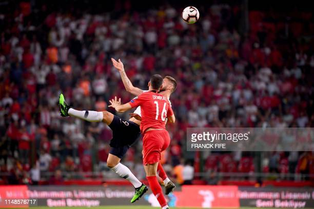 TOPSHOT France's Forward Olivier Giroud vies with Turkey's defender Merih Demiral during the Euro 2020 football qualification match between Turkey...