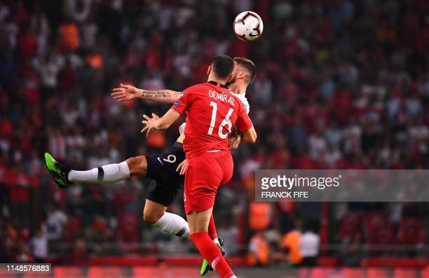 France's Forward Olivier Giroud vies with Turkey's defender Merih Demiral during the Euro 2020 football qualification match between Turkey and France...
