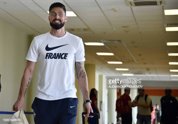 TOPSHOT France's forward Olivier Giroud walks at Moscow's Sheremetyevo airport on July 16 as the French national football team departs home after...
