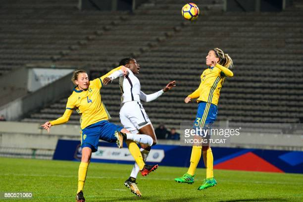 France's forward Ouleymata Sarr vies with Sweden's defender Emma Berglund during the friendly football match between France and Sweden on November 27...
