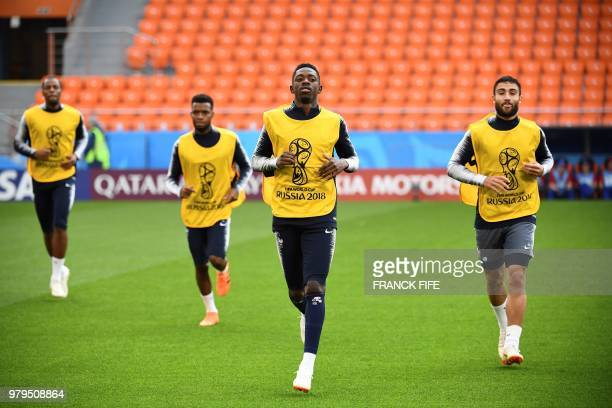 France's forward Ousmane Dembele and France's defender Adil Rami attend a training session at the Ekaterinburg Arena in Ekaterinburg on June 20 2018...