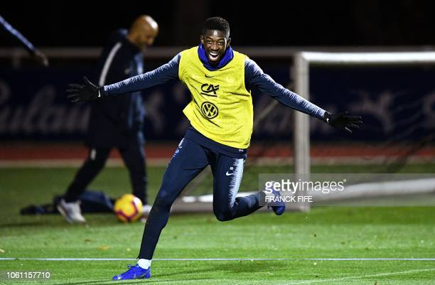 France's forward Ousmane Dembele celebrates at the end of a training session in ClairefontaineenYvelines near Paris on November 13 as part of the...
