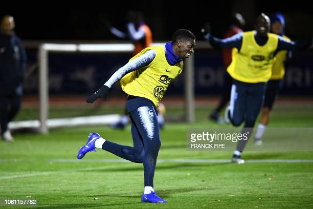 France's forward Ousmane Dembele celebrates at the end of a training session in Clairefontaine-en-Yvelines, near Paris, on November 13 as part of the...