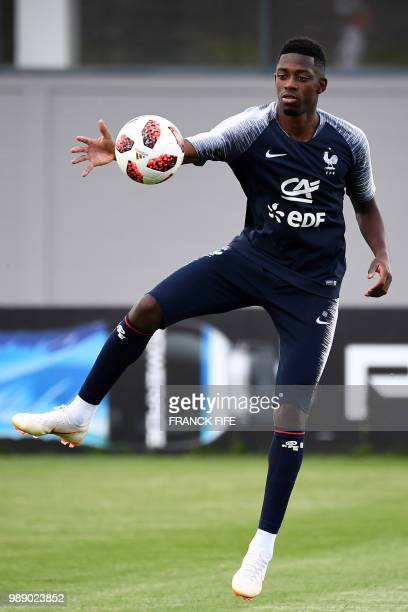 France's forward Ousmane Dembele eyes the ball during a training session at the Glebovets stadium in Istra some 70 km west of Moscow on July 1 ahead...