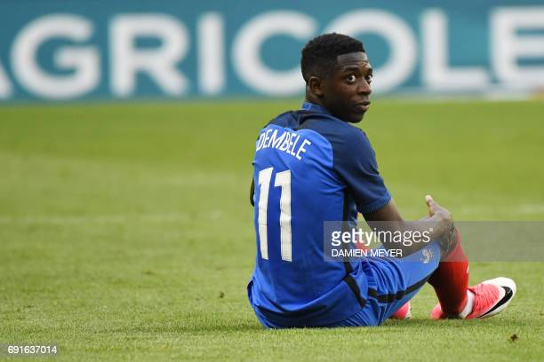 France's forward Ousmane Dembele looks on during the friendly football match between France and Paraguay on June 02 2017 at the Roazhon park stadium...