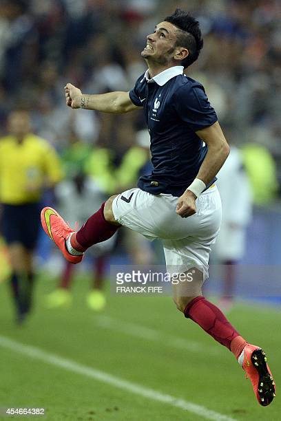 France's forward Remy Cabella jumps during the friendly football match France vs Spain on September 4 2014 at the Stade de France in SaintDenis north...