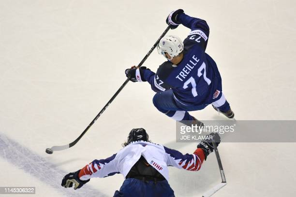 France's forward Sacha Treille vies for the puck during the IIHF Men's Ice Hockey World Championships Group A match between France and Great Britain...