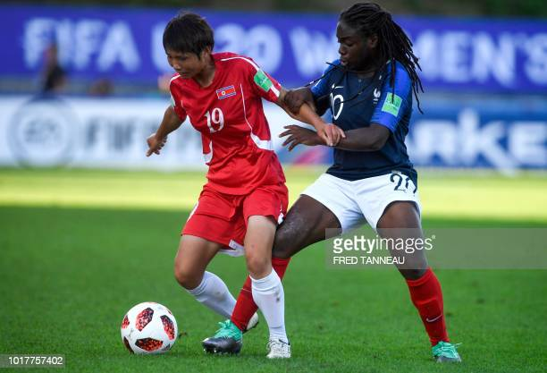 France's forward Sandy Baltimore vies for the ball with Korea DPR's defender Pom Hyang Ri during the women World Cup 2018 U20 football match between...