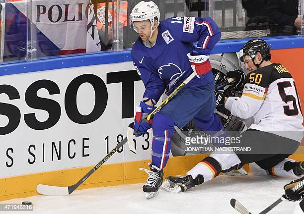 France's forward Stephane da Costa and Germany's forward Patrick Hager vie for the puck during the group A preliminary round match France vs Germany...