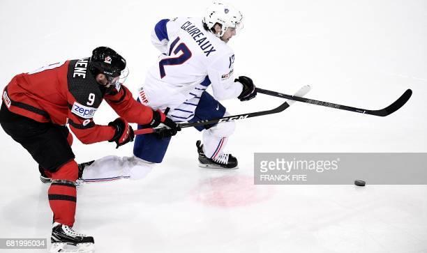 France's forward Valentin Claireaux vies with Canada's forward Matt Duchene during the IIHF Mens World Championship group B ice hockey match Canada...