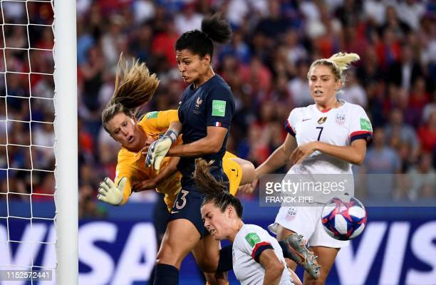TOPSHOT France's forward Valerie Gauvin jumps for the ball with United States' goalkeeper Alyssa Naeher during the France 2019 Women's World Cup...