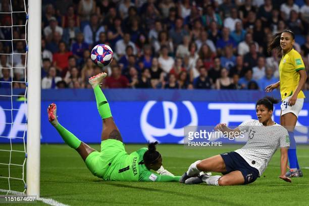 TOPSHOT France's forward Valerie Gauvin scores a goal despite Brazil's goalkeeper Barbara during the France 2019 Women's World Cup round of sixteen...