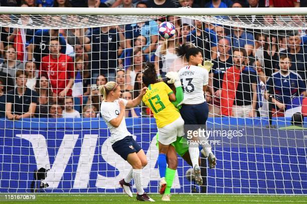 TOPSHOT France's forward Valerie Gauvin vies with Brazil's defender Leticia Santos on her way to score a goal during the France 2019 Women's World...