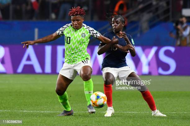 France's forward Viviane Asseyi vies for the ball with Nigeria's midfielder Rita Chikwelu during the France 2019 Women's World Cup Group A football...