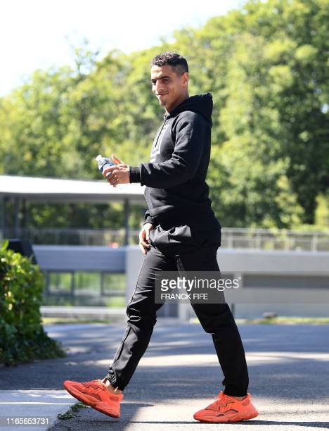 France's forward Wissam Ben Yedder arrives at the French national football team training base in Clairefontaine on September 2 as part of the team's...