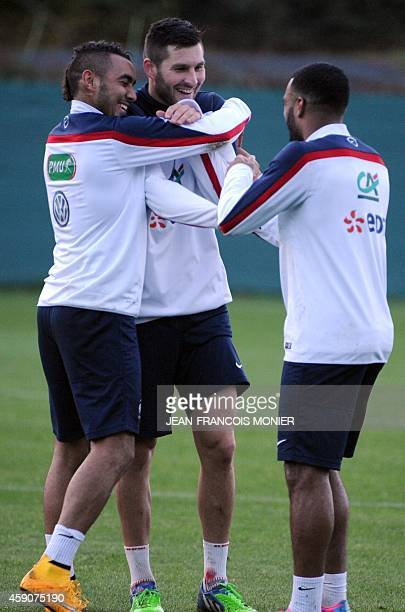 France's forwards Dimitri Payet AndrePierre Gignac and Alexandre Lacazette attend a training session two days before the team's friendly...