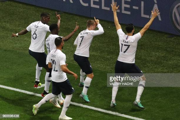 TOPSHOT France's foward Antoine Griezmann celebrates after scoring a penalty kick during the friendly football match between France and Italy at the...
