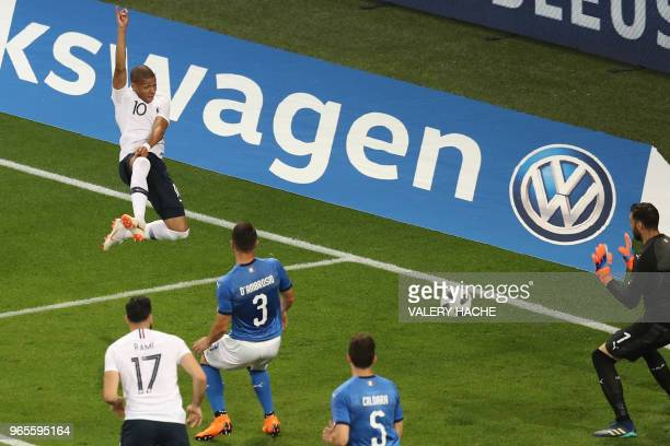 France's foward Kylian Mbappe kicks the ball during the friendly football match between France and Italy at the Allianz Riviera Stadium in Nice,...