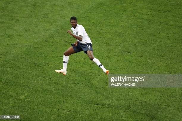TOPSHOT France's foward Ousmane Dembele celebrates after scoring a goal during the friendly football match between France and Italy at the Allianz...