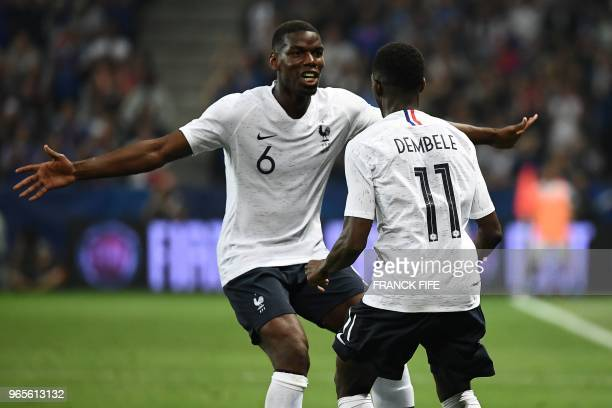 France's foward Ousmane Dembele celebrates with France's midfielder Paul Pogba after scoring a goal during the friendly football match between France...