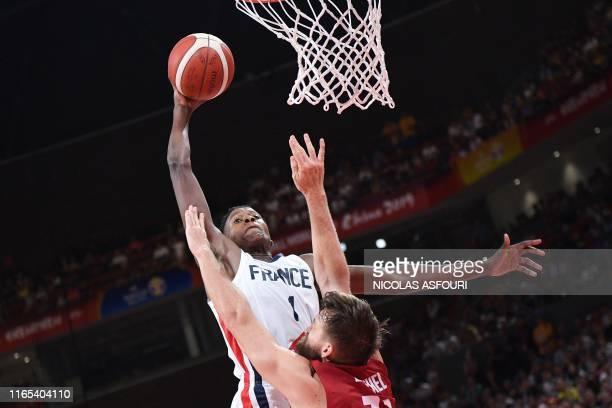TOPSHOT France's Frank Ntilikina shots past Germany's Danilo Barthel during the Basketball World Cup Group G game between France and Germany in...