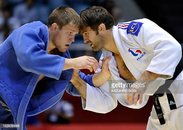 France's Frederic Stiegelmann fights with Kazakhstan's Maxim Rakov during the men's 100kg class second round match at the 2010 World Judo...