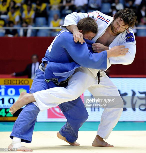 France's Frederic Stiegelmann tries to throw Kazakhstan's Maxim Rakov during the men's 100kg class second round match at the 2010 World Judo...