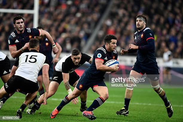 France's French fullback Brice Dulin runs with the ball during the rugby union Test match between France and New Zealand on November 26 at the Stade...