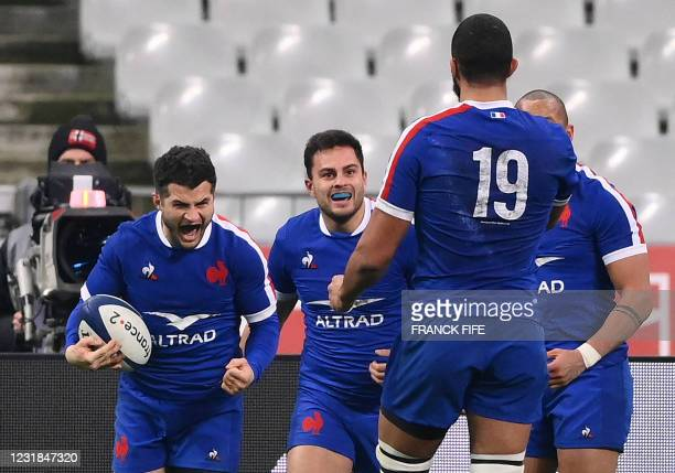 France's full back Brice Dullin celebrates after scoring a try at the end of the Six Nations rugby union tournament match between France and Wales on...