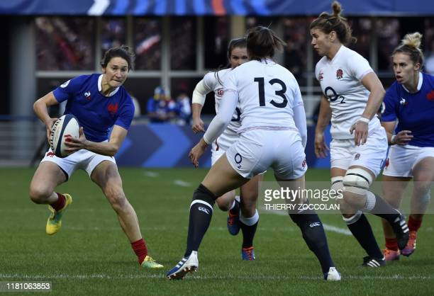 France's full back Jessy Tremouliere runs with the ball during the international women's Rugby union test match between France and England at the...